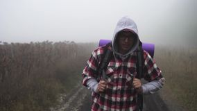 A lost hiker in the fog stock video