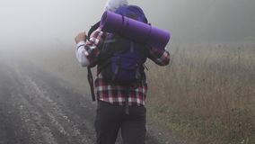 A lost hiker in the fog