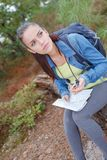 Lost hiker girl with map on forest road. Lost hiker girl with map on the forest road Royalty Free Stock Photo