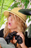 Lost in the jungle. Beautiful young woman lost in the jungle looking for a way out Royalty Free Stock Photography