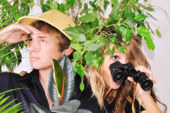 Lost in the jungle. Young couple lost in the jungle looking for a way out Royalty Free Stock Photos