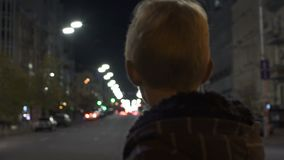 Lost kid standing alone on street, police patrol searching for missing child. Stock footage stock video