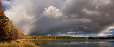 Lost Lake. An impressive group of clouds captured in a panorama photograph, pass over a wilderness lake in the Wisconsin northwoods royalty free stock photo