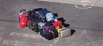 Lost Luggage. Colorful pile of lost luggage left. Also can cause concern over security i.e bomb alerts stock photo