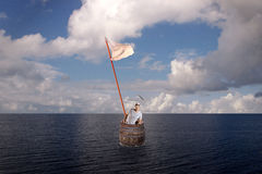 Lost Man in Barrel on Sea. Lost Man in Wooden Barrel and White Flag-Lost Concept Stock Image