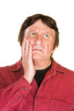 Lost Man with Hand on Cheek Stock Photo