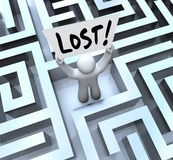 Lost Man Holding Sign in Labyrinth Maze. The word Lost on a sign held by a man or person stuck in a maze or labyrinth looking for a way out or to be rescued royalty free illustration
