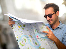 Lost man with a map Stock Photos
