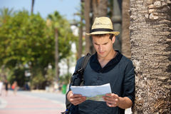 Lost man with map and bag standing outside. Portrait of a lost man with map and bag standing outside Royalty Free Stock Photo