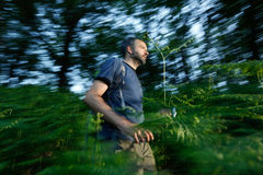 Lost man running through the woods Stock Images