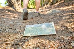Lost the map. Hiker who lost the map on the road Stock Photography