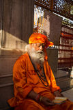 Lost in Meditation. An old saint in an Indian Temple lost reading the holy verses Stock Photo