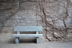 Lost memories. Stone bench in the winter Stock Photos