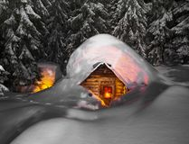 Fairy-tale snow-covered house in the mountains royalty free stock photos