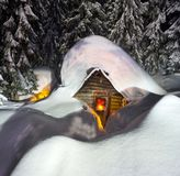 Fairy-tale snow-covered house in the mountains royalty free stock photography