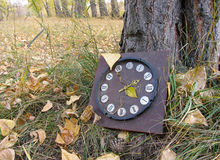 Lost old clock. Broken lost clock Royalty Free Stock Images