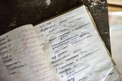 Lost opened notebook in abandoned school in Pripyat. Pripyat, Ukraine - May 29, 2016: lost opened notebook in abandoned school in Pripyat, Chernobyl, Ukraine Royalty Free Stock Image