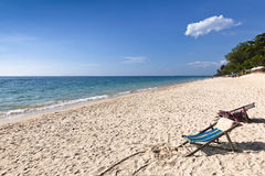 Lost paradise. Two empty chairs waiting on a lonely beach Stock Photos