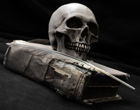 The lost pirates log. A classic still life with book and human skull Royalty Free Stock Photo