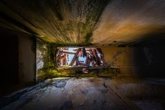 Lost place abandoned hall with broken roof and moss, mold stock photography