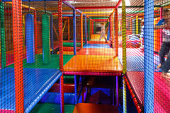 Lost in the playground maze. Lost in the Colorful 3D Net Maze indoor playground for kids with bumpers, punching cylinder, slide, bridge, balls Stock Images