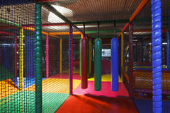 Lost in the playground maze. Lost in the Colorful 3D Net Maze indoor playground for kids with bumpers, punching cylinder, slide, bridge, balls royalty free stock photography