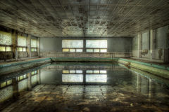 The Lost Pool. A unique abandoned swimming pool in a decayed Soviet military hospital somewhere in Poland stock image