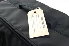 Lost property lable on black bag Stock Photos