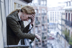 Lost and sad woman at home balcony suffering depression looking thoughtful and solitary Royalty Free Stock Photography