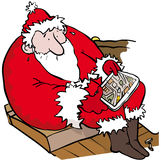 Lost santa. Father Christmas lost  looking at map on a tablet at dawn Royalty Free Stock Photo