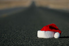 Lost santa hat. End of christmas holidays - a lost or abandoned santa hat lies on the highway. shallow dof with focus on hat Royalty Free Stock Images
