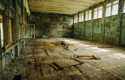Lost school sport gym at Chernobyl city zone of radioactivity gh. Ost town Stock Photography