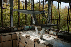 Lost school sport gym with swimming pool at Chernobyl city zone. Of radioactivity ghost town Royalty Free Stock Photos