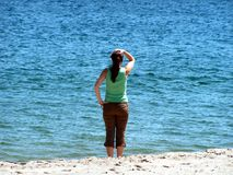 Lost at sea. A girl looks out to sea Stock Photo