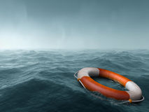Lost at sea. Lifebuoy floating in the vast expanse of sea Stock Photography