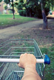 Lost with shopping cart in park Royalty Free Stock Photos