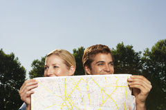 Lost Smiling Couple With Map Stock Images