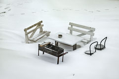 Lost in the snow. Table and benches covered with snow on Rybinsk lake. The winter picnic Royalty Free Stock Image