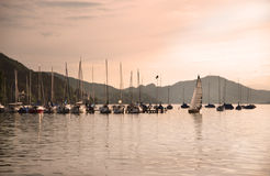 Lost in solitude. Mountain lake and several boats Stock Photography