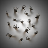 Lost souls. 3D render of ghostly hands reaching up behind frosted glass Stock Photo