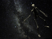 Lost in space. A human skeleton floating weightless towards the constellation Lyra in the Milky Way Royalty Free Stock Photos