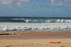 Lost surfboard. On a beach in North Shore Oahu Royalty Free Stock Image