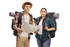 Lost teenage tourists with a map. Isolated on white background Royalty Free Stock Photo
