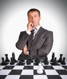 Lost in thought businessman and chess board Stock Photo