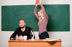 Lost in thoughts. Couple of man and woman in classroom. Student life. Lesson and blackboard. Teachers day. Modern school royalty free stock photography