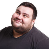 Lost in thoughts, smiling fat man with thoughtful face Stock Images