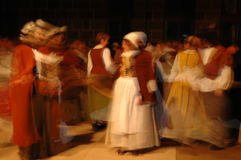 Lost in time. A group of people in historical costumes dancing deliberately and calmly to the medieval music Royalty Free Stock Photos