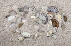 Lost time. Antique watch faces in the sand. Lost time concept Stock Image