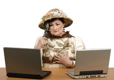 Lost in time old woman reading the news on the laptop Royalty Free Stock Photo