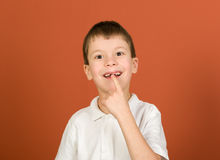 Lost tooth boy portrait on brown Stock Images